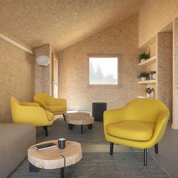 Le salon de l'éco-chalet bois se veut cosy et accueillant © Micha Riechsteiner